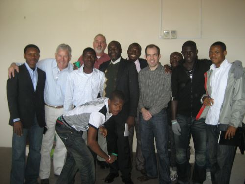 Don, Ken, and Greg take a photo with the Nigerian Soccer players.